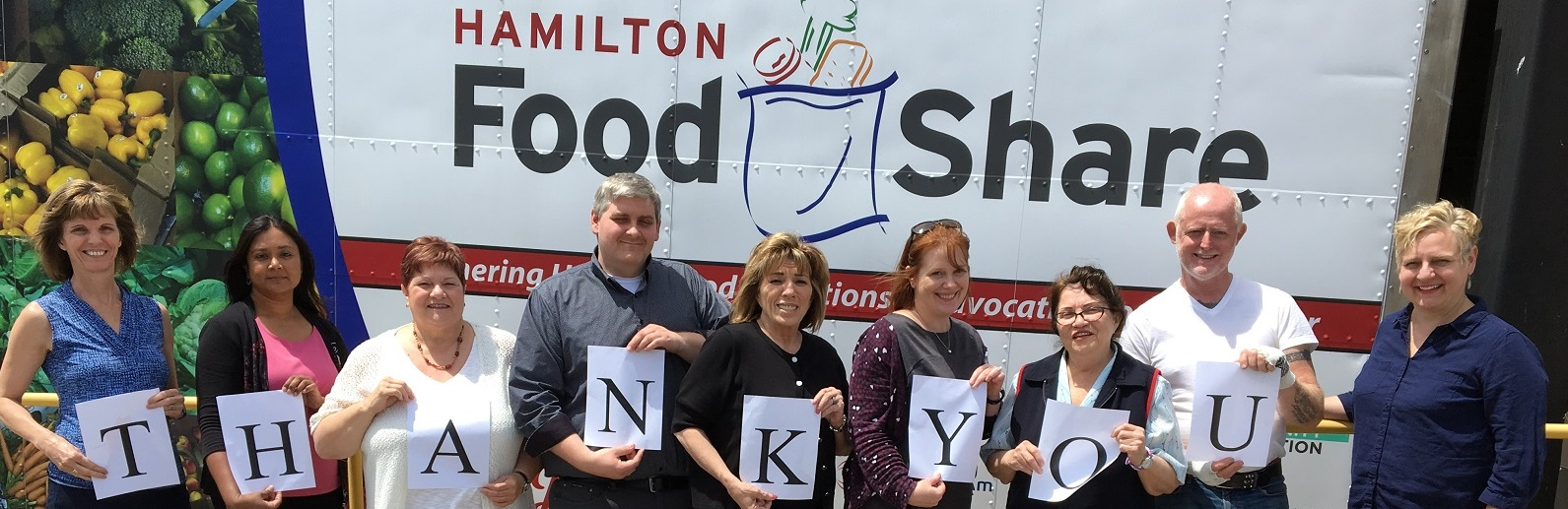 Hamilton Food Share staff holding thank you signs